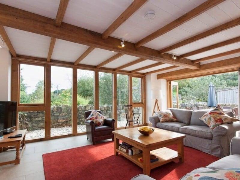 Lounge with bi-fold doors to patio area