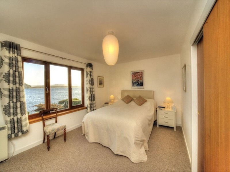 Bedroom 1 with views over the sea. Double with en suite shower room.