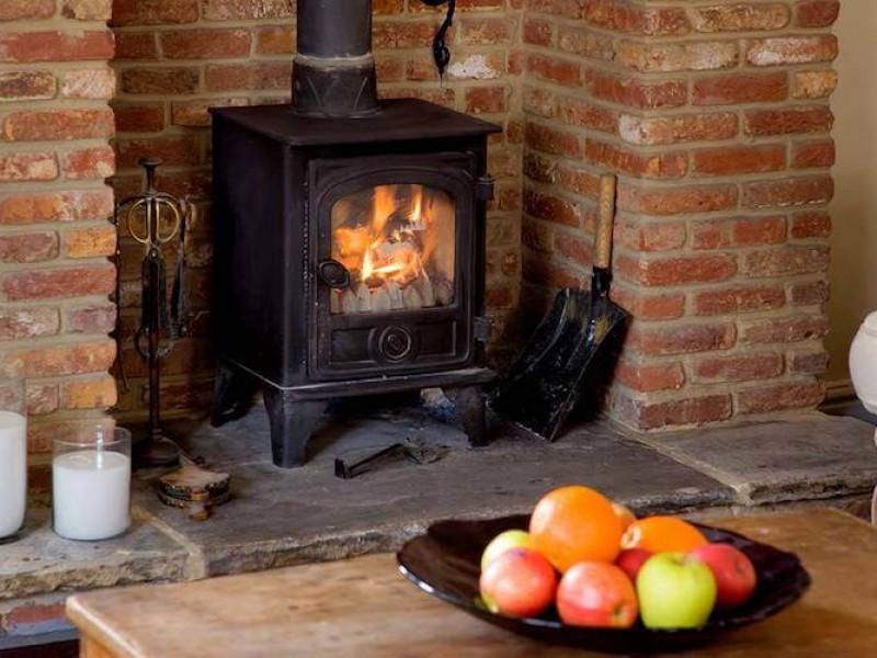 Morton House - wood burner in TV room
