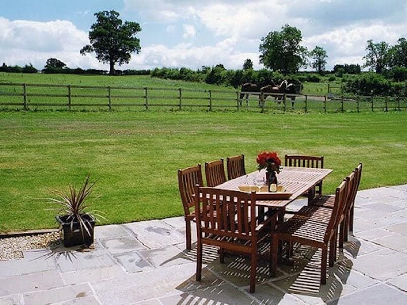 Patio Area At Newborough Cottages