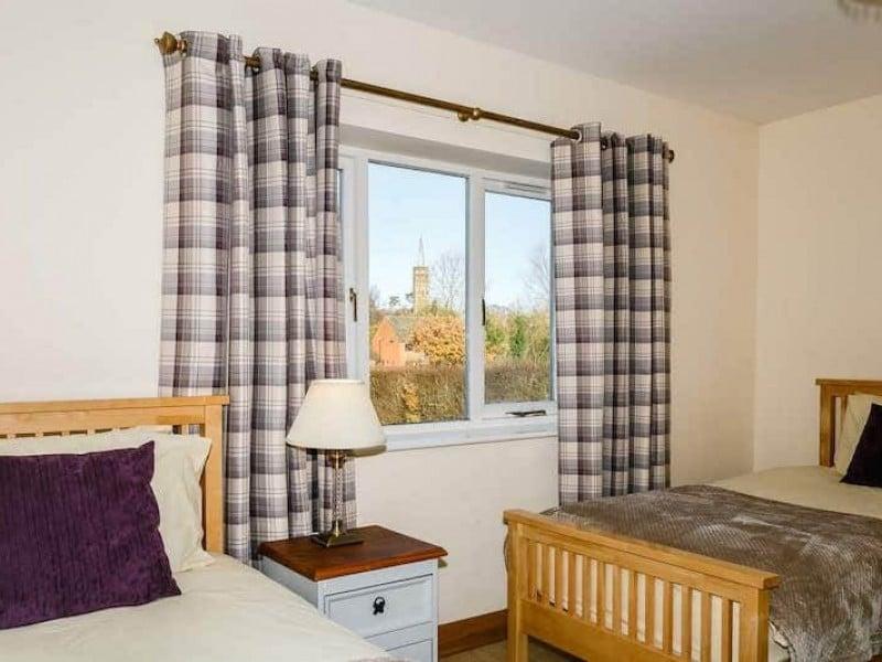 The Poplars Ground floor bedroom At Newborough Cottages