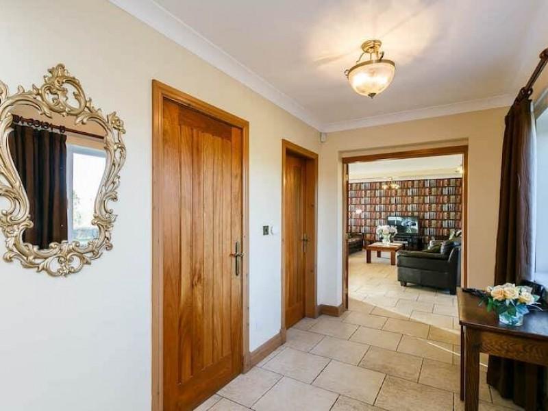 Poplars spacious hallway At Newborough Cottages