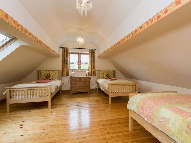 One of our 2 Triple Rooms At Newborough Cottages