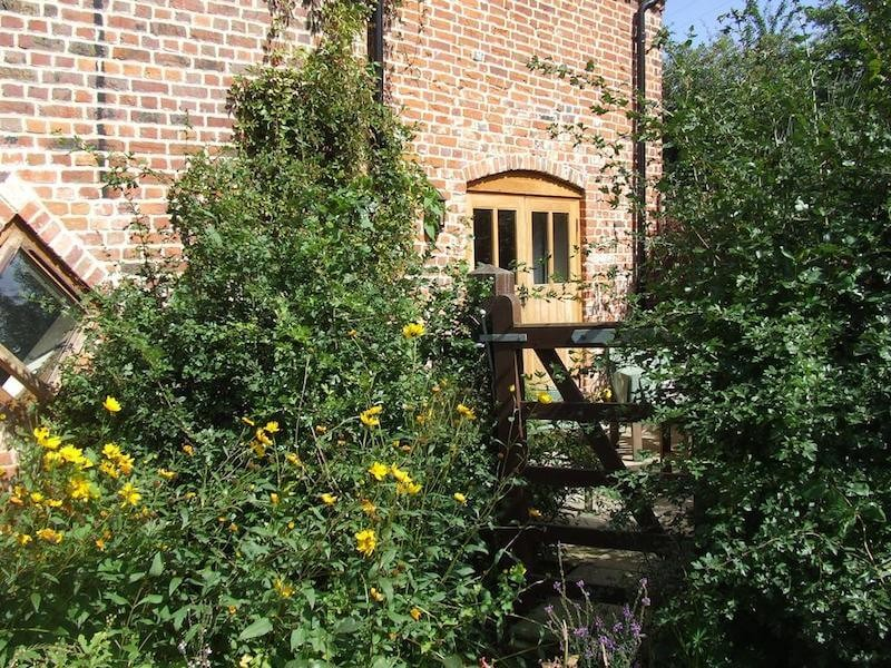 Marsh Cottage At Camps Heath Barn Courtyard Summer