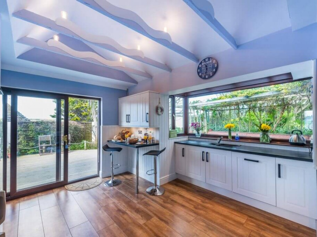 The kitchen with french doors to the sun-deck