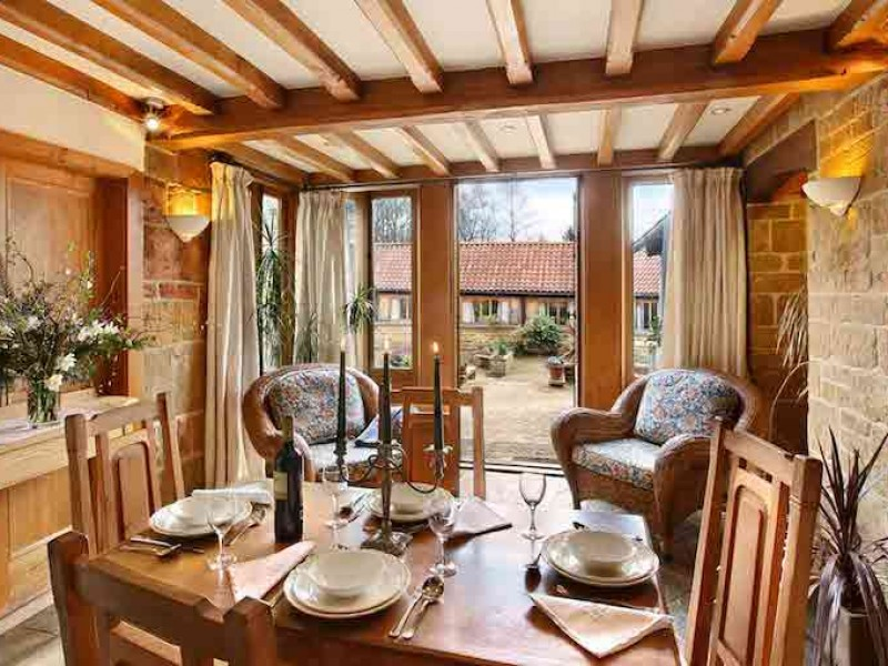 Chestnut Dining Area with French Doors to Courtyard