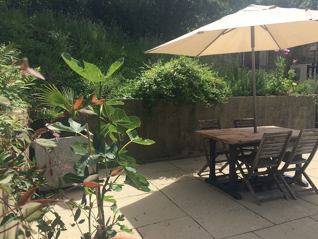 There are several places to eat or drink on the terrace or around the garden