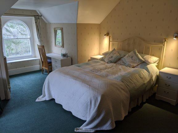 Garden room with sea view and en-suite