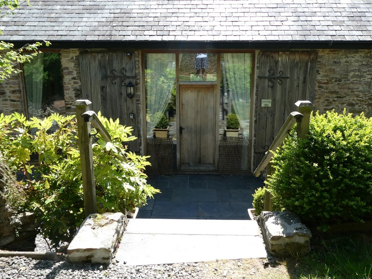 Entrance to Nutcombe Barn at Nutcombe Holiday Cottages