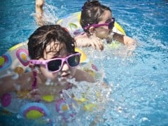 Children swimming in a family lodges with a private pool