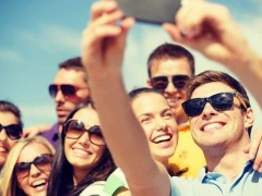 People on a group holiday taking a selfie