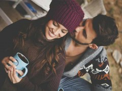 Romantic getaway travel cosy couple with hot chocolate